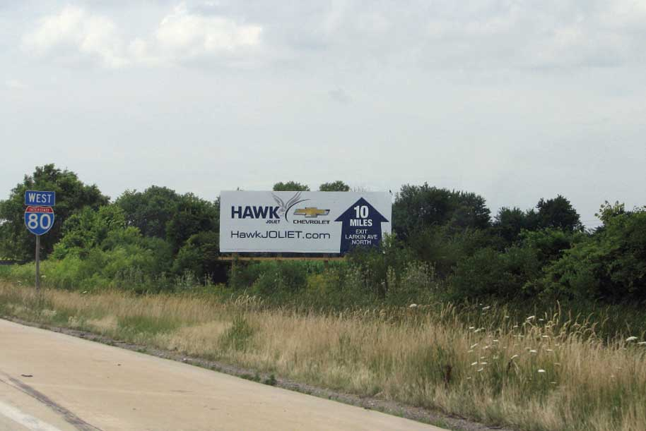 Billboard at North side of I-80 East of Cedar Rd.