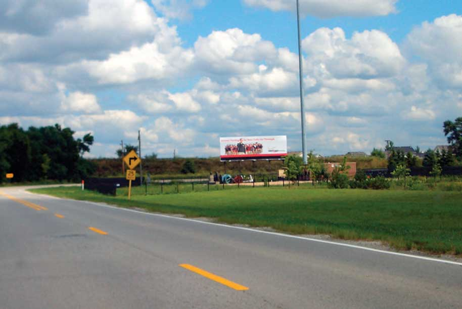 Billboard at East side of Frontage Road at Airport Road